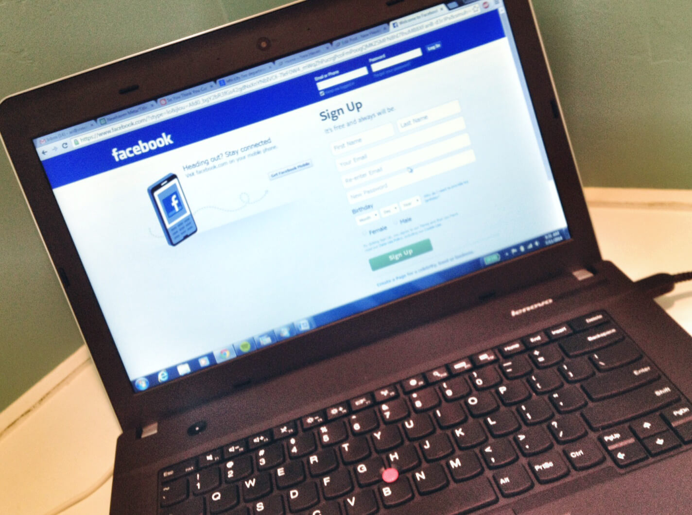 A laptop with the facebook login page on display