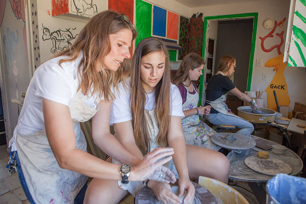 A group of New Haven Students taking a pottery class